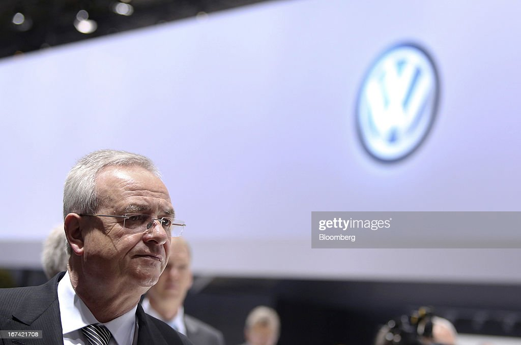 Martin Winterkorn, chief executive officer of Volkswagen AG, passes through a display of automobiles at the company's annual general meeting (AGM) in Hanover, Germany, on Thursday, April 25, 2013. Volkswagen AG, Europe's biggest automaker, aims to offset plunging European demand this year by rolling out 60 new and updated models, including luxury cruisers like the Bentley Flying Spur. Photographer: Chris Ratcliffe/Bloomberg via Getty Images