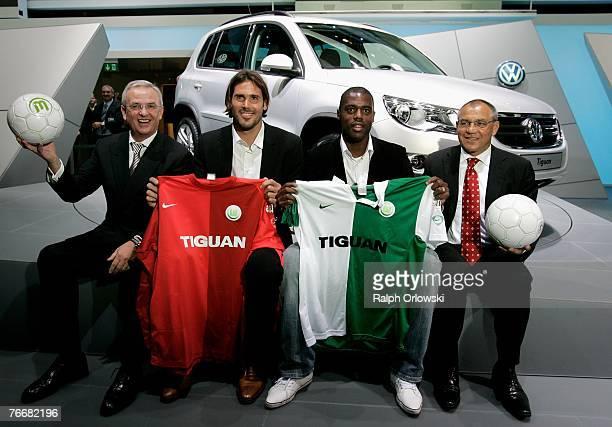 Martin Winterkorn head of Volkswagen Group sponsor of Bundesliga 1st soccer team VFL Wolfsburg and goalkeeper Simon Jentsch Grafiti and coach Felix...