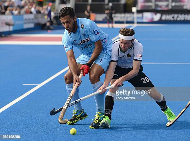 Martin Zwicker of Germany tackles Harmanpreet Singh of India during the FIH Men's Hero Hockey Champions Trophy 2016 Day One match between Germany and...