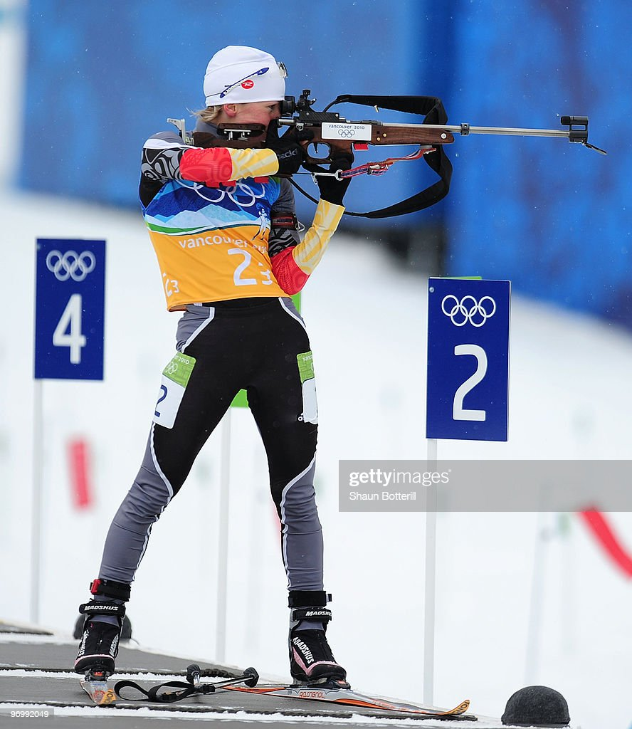 <a gi-track='captionPersonalityLinkClicked' href=/galleries/search?phrase=Martina+Beck&family=editorial&specificpeople=5543827 ng-click='$event.stopPropagation()'>Martina Beck</a> of Germany takes aim whilst firing in the standing position during the women's biathlon 4 x 6km relay on day 12 of the 2010 Vancouver Winter Olympics at Whistler Olympic Park Cross-Country Stadium on February 23, 2010 in Whistler, Canada.