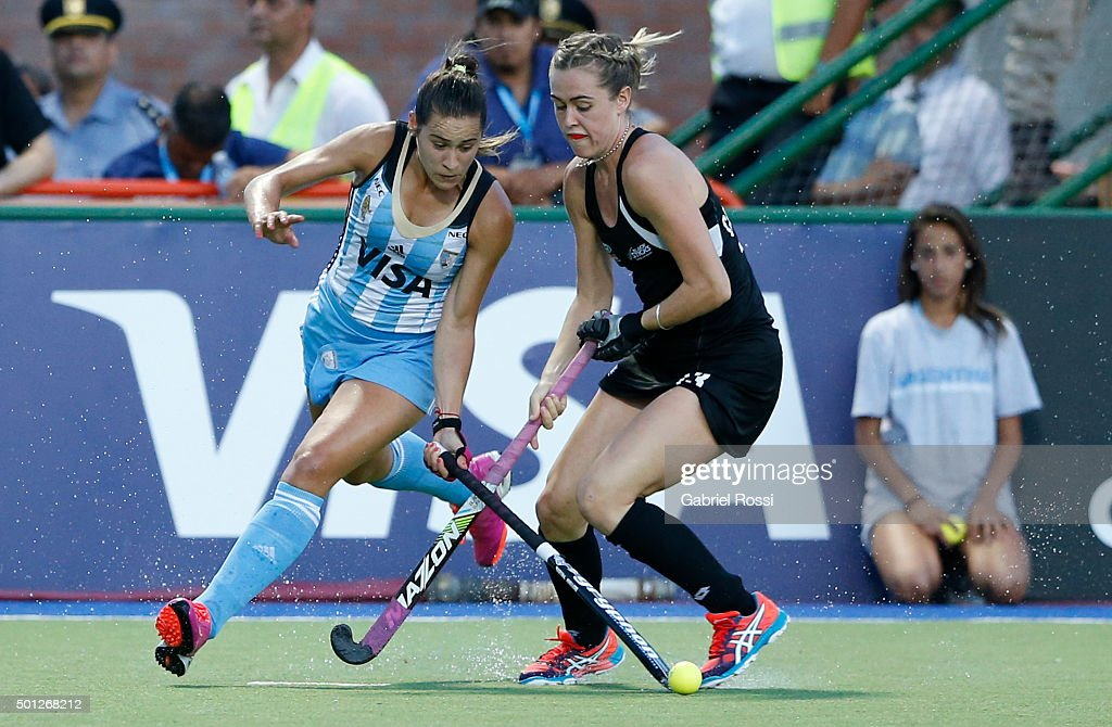 <a gi-track='captionPersonalityLinkClicked' href=/galleries/search?phrase=Martina+Cavallero&family=editorial&specificpeople=8825533 ng-click='$event.stopPropagation()'>Martina Cavallero</a> of Argentina (L) fights for the ball with <a gi-track='captionPersonalityLinkClicked' href=/galleries/search?phrase=Samantha+Charlton&family=editorial&specificpeople=9604124 ng-click='$event.stopPropagation()'>Samantha Charlton</a> of New Zealand (R) during a final match between Argentina and New Zealand as part of Day 9 of the Hockey World League Final Rosario 2015 at Mundialista Stadium on December 13, 2015 in Rosario, Argentina.