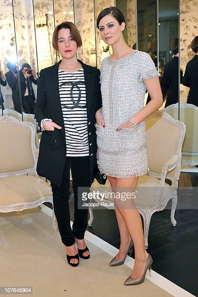 Martina Codecasa and Anna Mouglalis attend 'La Passeggiata' Chanel Party on December 16 2010 in Milan Italy
