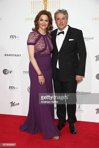Martina Gedeck and partner Markus Imboden arrive for the Lola German Film Award 2013 at FriedrichstadtPalast on April 26 2013 in Berlin Germany