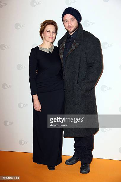 Martina Gedeck and Ronald Zehrfeld arrive for the premiere of 'Tannbach Schicksal eines Dorfes' at Sony Center on December 16 2014 in Berlin Germany