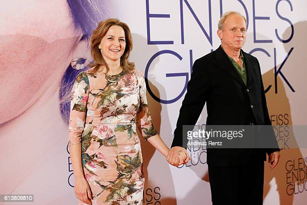 Martina Gedeck and Ulrich Tukur attend the NRW premiere of the film 'Gleissendes Glueck' at Lichtburg on October 10 2016 in Essen Germany