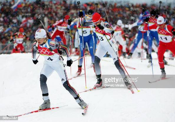 Martina Glagow of Germany is followed by fellow countrywoman Kati Wilhelm in the Womens Biathlon 125km Mass Start Final on Day 15 of the 2006 Turin...