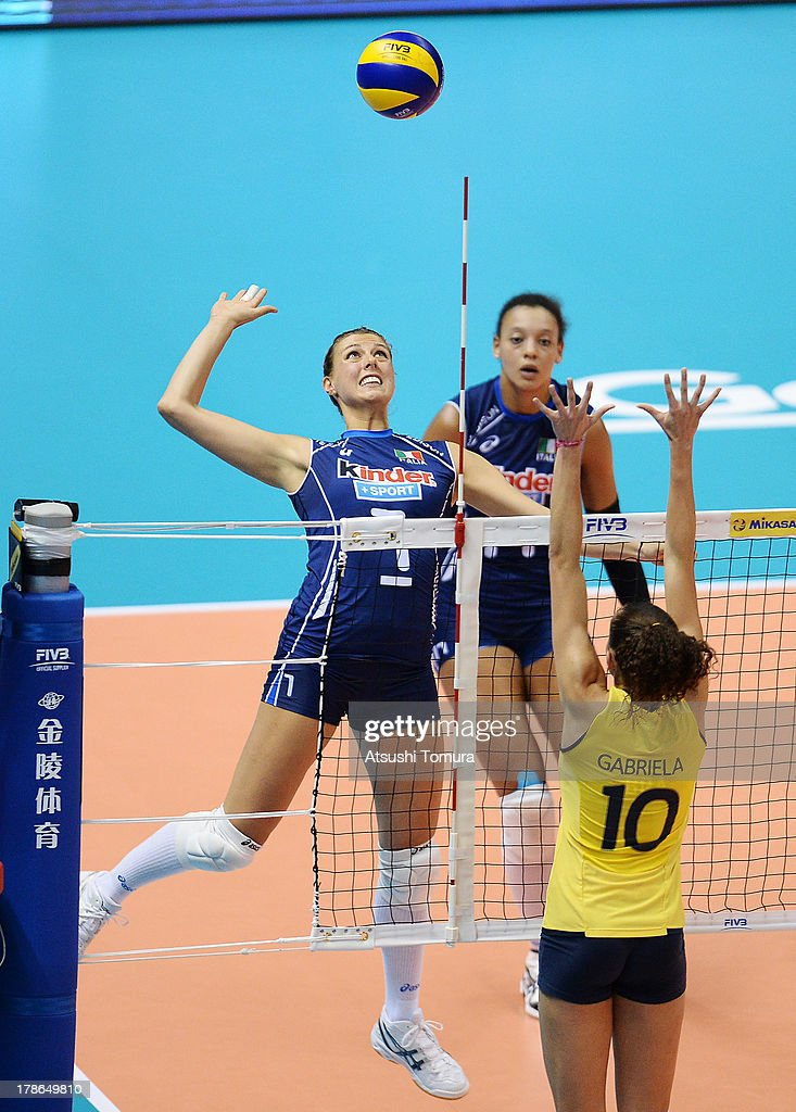 Martina Guiggi of Italy spikes the ball during day three of the FIVB World Grand Prix Sapporo 2013 match between Brazil and Italy at Hokkaido Prefectural Sports Center on August 30, 2013 in Sapporo, Hokkaido, Japan.