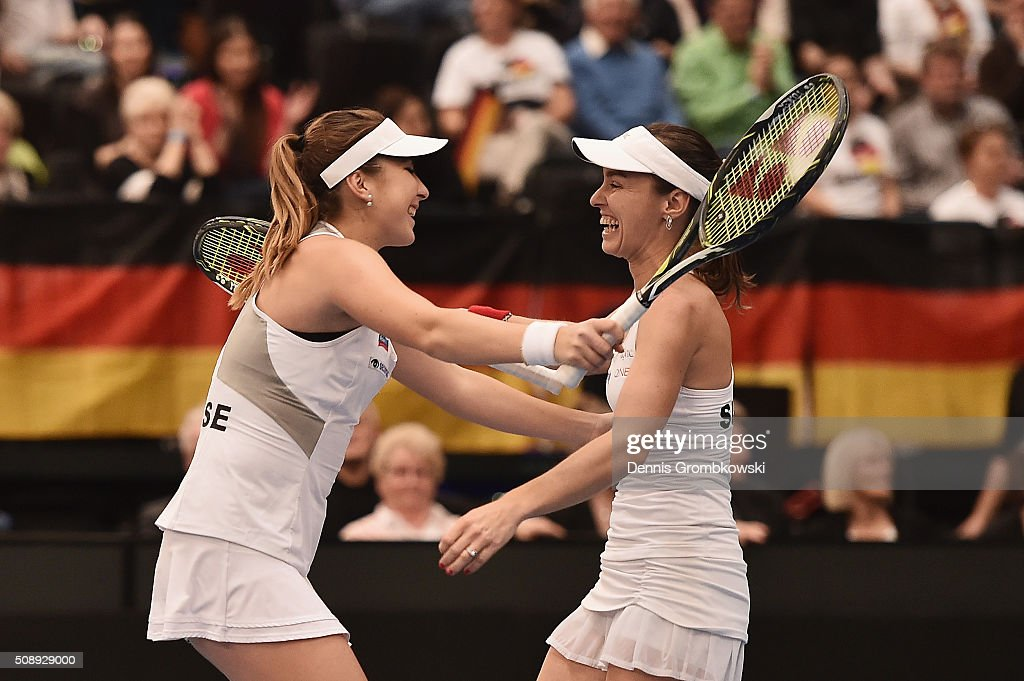 <a gi-track='captionPersonalityLinkClicked' href=/galleries/search?phrase=Martina+Hingis&family=editorial&specificpeople=202183 ng-click='$event.stopPropagation()'>Martina Hingis</a> and <a gi-track='captionPersonalityLinkClicked' href=/galleries/search?phrase=Belinda+Bencic&family=editorial&specificpeople=8837181 ng-click='$event.stopPropagation()'>Belinda Bencic</a> of Switzerland celebrate victory after their double match against Andrea Petkovic and Anna-Lena Groenefeld of Germany on Day 2 of the 2016 FedCup World Group Round 1 match between Germany and Switzerland at Messe Leipzig on February 7, 2016 in Leipzig, Germany.
