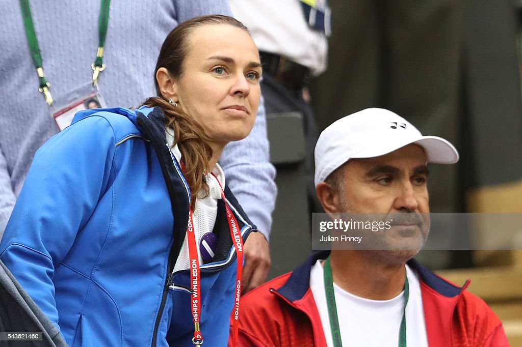 The coach of Belinda Bencic of Switzerland watches on as Belinda Bencic plays during the Ladies Singles second round match against Tsvetana Pironkova of Bulgaria on day three of the Wimbledon Lawn Tennis Championships at the All England Lawn Tennis and Croquet Club on June 29, 2016 in London, England.