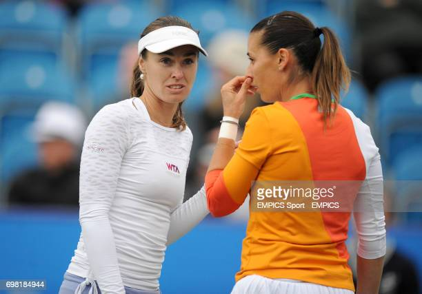 Martina Hingis and Flavia Pennetta during their doubles match with against Ekaterina Makarova and Elena Vesnina during the AEGON International at...