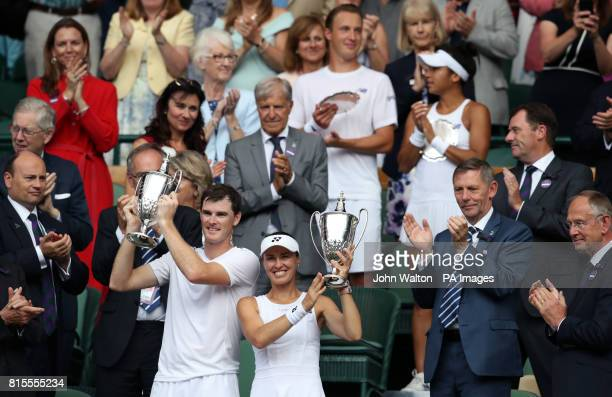 Martina Hingis and Jamie Murray celebrate victory in the mixed doubles final against Heather Watson and Henri Kontinen on day thirteen of the...