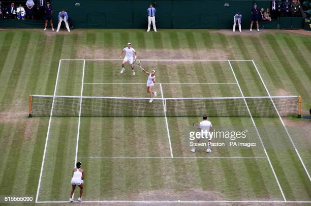 Martina Hingis and Jamie Murray during the mixed doubles final against Heather Watson and Henri Kontinen on day thirteen of the Wimbledon...
