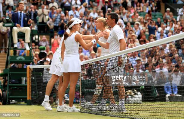 Martina Hingis and Jamie Murray shake hands with Ken Skupski and Jocelyn Rae after their doubles match on day ten of the Wimbledon Championships at...
