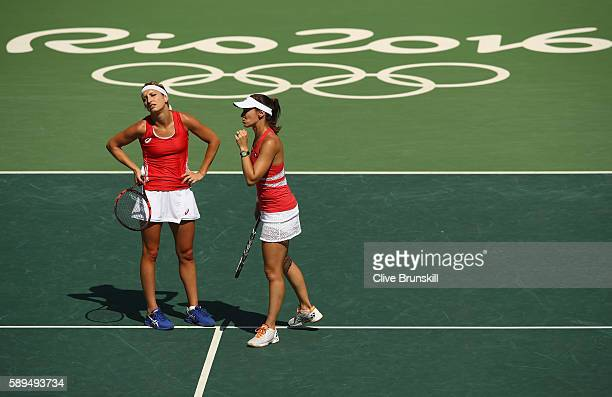 Martina Hingis and Timea Bacsinszky of Switzerland look dejected during the women's doubles gold medal match against Elena Vesnina and Ekaterina...