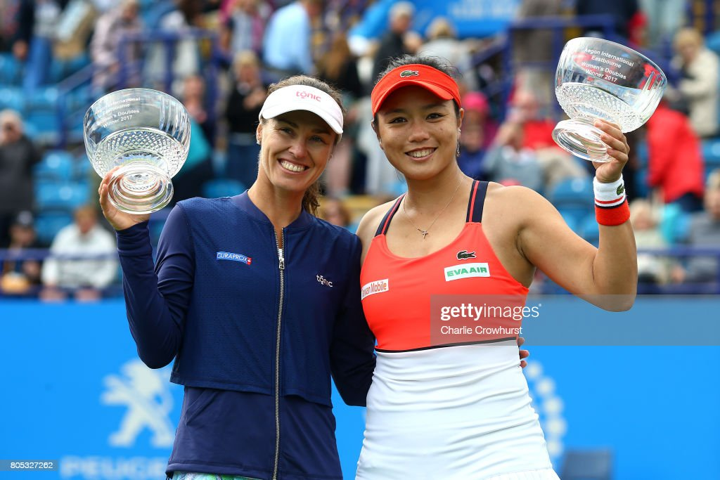 Martina Hingis and Yung-Jan Chan celebrate with trophies after winning their women's doubles final match against of Ashleigh Barty and Casey Dellacqua of Australia during day seven of the Aegon International Eastbourne on July 1, 2017 in Eastbourne, England.