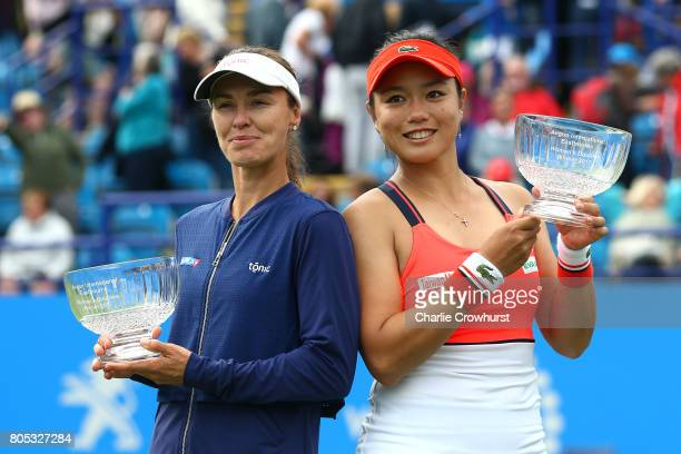 Martina Hingis and YungJan Chan celebrate with trophies after winning their women's doubles final match against of Ashleigh Barty and Casey Dellacqua...