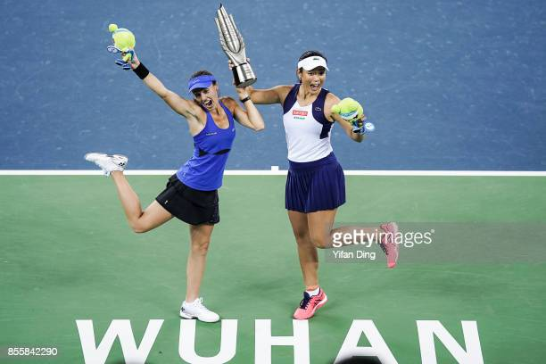 Martina Hingis and YungJan Chan hold the champion trophy at the award ceremony after wnning the ladies doubles final between Martina Hingis of...