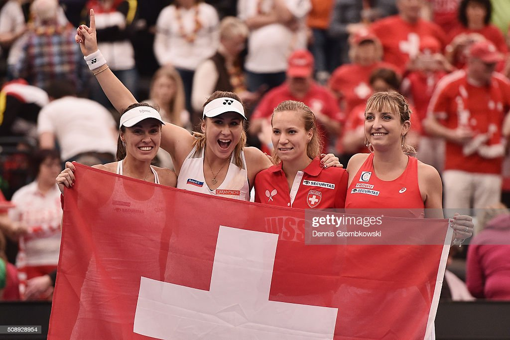 Martina Hingis, Belinda Bencic, Viktorija Golubic and Timea Bacsinszky of Switzerland celebrate on Day 2 of the 2016 FedCup World Group Round 1 match between Germany and Switzerland at Messe Leipzig on February 7, 2016 in Leipzig, Germany.