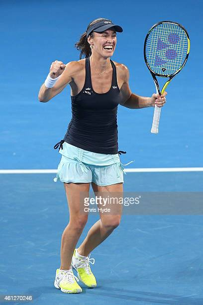 Martina Hingis celebrates after winning the Womens doubles final partnered with Sabine Lisicki against Caroline Garcia and Katarina Srebotnik during...