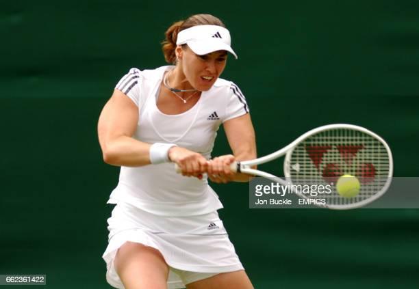 Martina Hingis in action against Naomi Cavadayin