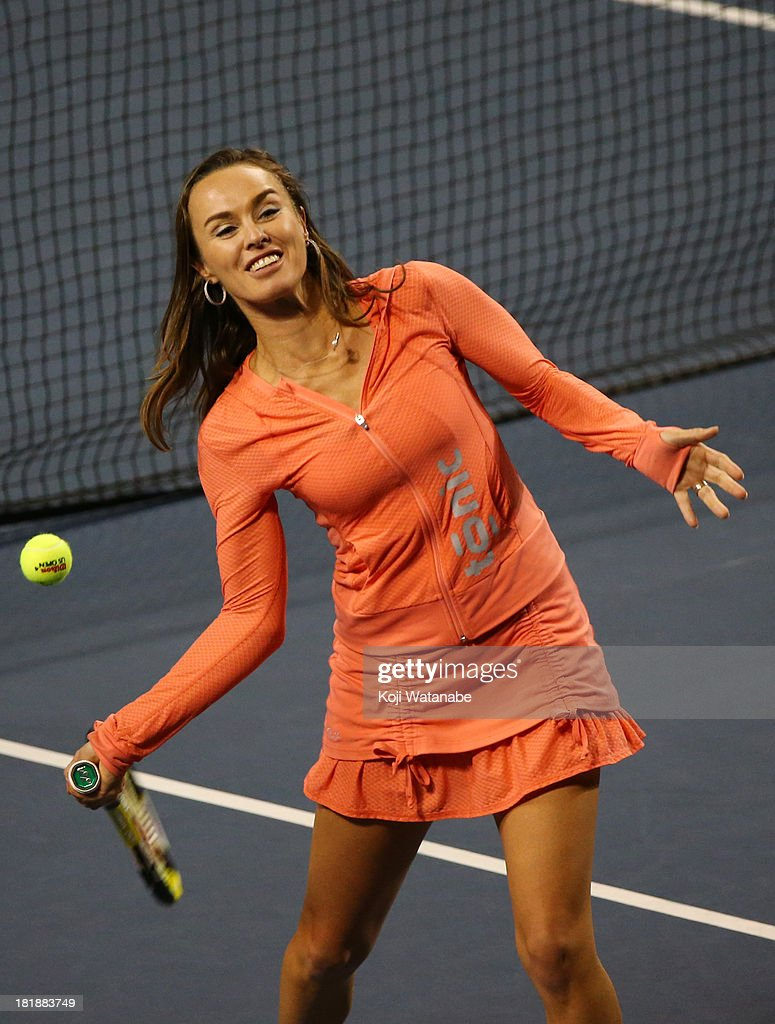 Martina Hingis makes a visit and shoots tennis balls into audience on day five of the Toray Pan Pacific Open at Ariake Colosseum on September 26, 2013 in Tokyo, Japan.