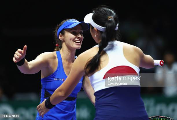 Martina Hingis of Switzerland and Chan YungJan of Chinese Taipei celebrate victory in their doubles match against Kveta Peschke of Czech Republic and...