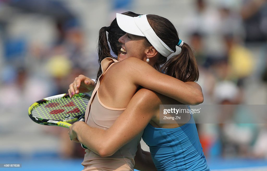 <a gi-track='captionPersonalityLinkClicked' href=/galleries/search?phrase=Martina+Hingis&family=editorial&specificpeople=202183 ng-click='$event.stopPropagation()'>Martina Hingis</a> of Switzerland and <a gi-track='captionPersonalityLinkClicked' href=/galleries/search?phrase=Flavia+Pennetta&family=editorial&specificpeople=220518 ng-click='$event.stopPropagation()'>Flavia Pennetta</a> of Italy react after winning their doubles final match against Cara Black of Zimbabwe and Caroline Garcia of France on day seven of 2014 Dongfeng Motor Wuhan Open at Optics Valley International Tennis Center on September 27, 2014 in Wuhan, China.