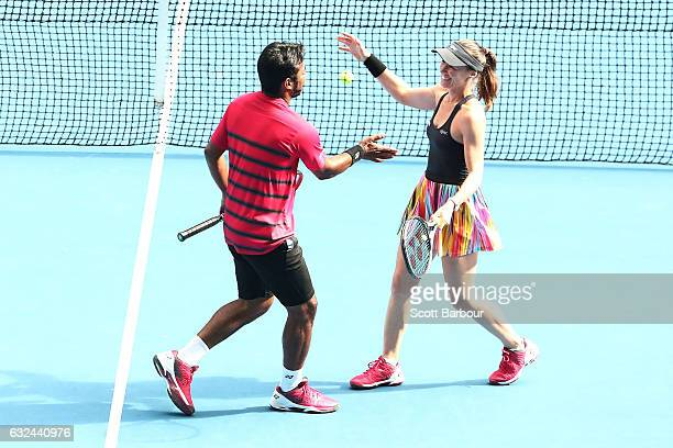 Martina Hingis of Switzerland and Leander Paes of India celebrate winning their second round mixed doubles match against Casey Dellacqua and Matt...