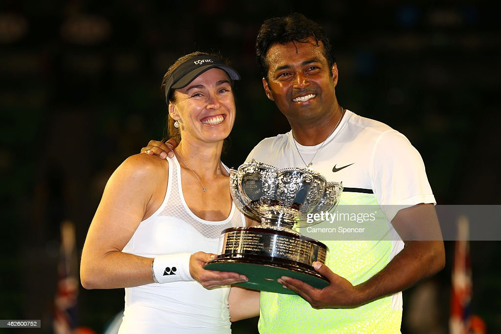 <a gi-track='captionPersonalityLinkClicked' href=/galleries/search?phrase=Martina+Hingis&family=editorial&specificpeople=202183 ng-click='$event.stopPropagation()'>Martina Hingis</a> of Switzerland and <a gi-track='captionPersonalityLinkClicked' href=/galleries/search?phrase=Leander+Paes&family=editorial&specificpeople=215327 ng-click='$event.stopPropagation()'>Leander Paes</a> of India hold the winners trophy after their final mixed doubles match against Kristina Mladenovic of France and Daniel Nestor of Canada during day 14 of the 2015 Australian Open at Melbourne Park on February 1, 2015 in Melbourne, Australia.