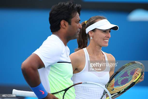 Martina Hingis of Switzerland and Leander Paes of India in action in their first round mixed doubles match against Masa Jovanovic and Sam Thompson of...