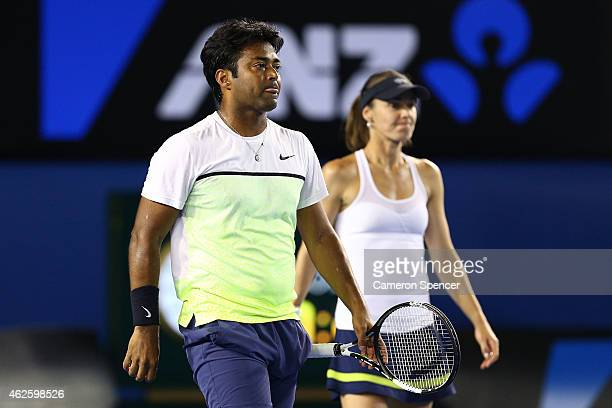 Martina Hingis of Switzerland and Leander Paes of India in action in their final mixed doubles match against Kristina Mladenovic of France and Daniel...