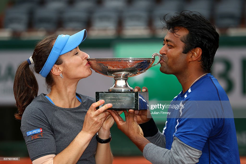 <a gi-track='captionPersonalityLinkClicked' href=/galleries/search?phrase=Martina+Hingis&family=editorial&specificpeople=202183 ng-click='$event.stopPropagation()'>Martina Hingis</a> of Switzerland and <a gi-track='captionPersonalityLinkClicked' href=/galleries/search?phrase=Leander+Paes&family=editorial&specificpeople=215327 ng-click='$event.stopPropagation()'>Leander Paes</a> of India kiss the trophy following victory during the Mixed Doubles final match against Sania Mirza of India and Ivan Dodig of Croatia on day thirteen of the 2016 French Open at Roland Garros on June 3, 2016 in Paris, France.