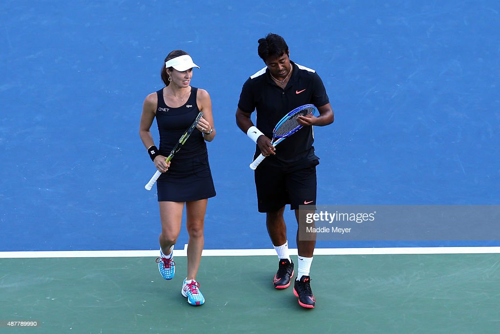 Martina Hingis of Switzerland and Leander Paes of India react against Bethanie Mattek-Sands of the United States and Sam Querrey of the United States in their Mixed Doubles Final match on Day Twelve of the 2015 US Open at the USTA Billie Jean King National Tennis Center on September 11, 2015 in the Flushing neighborhood of the Queens borough of New York City.