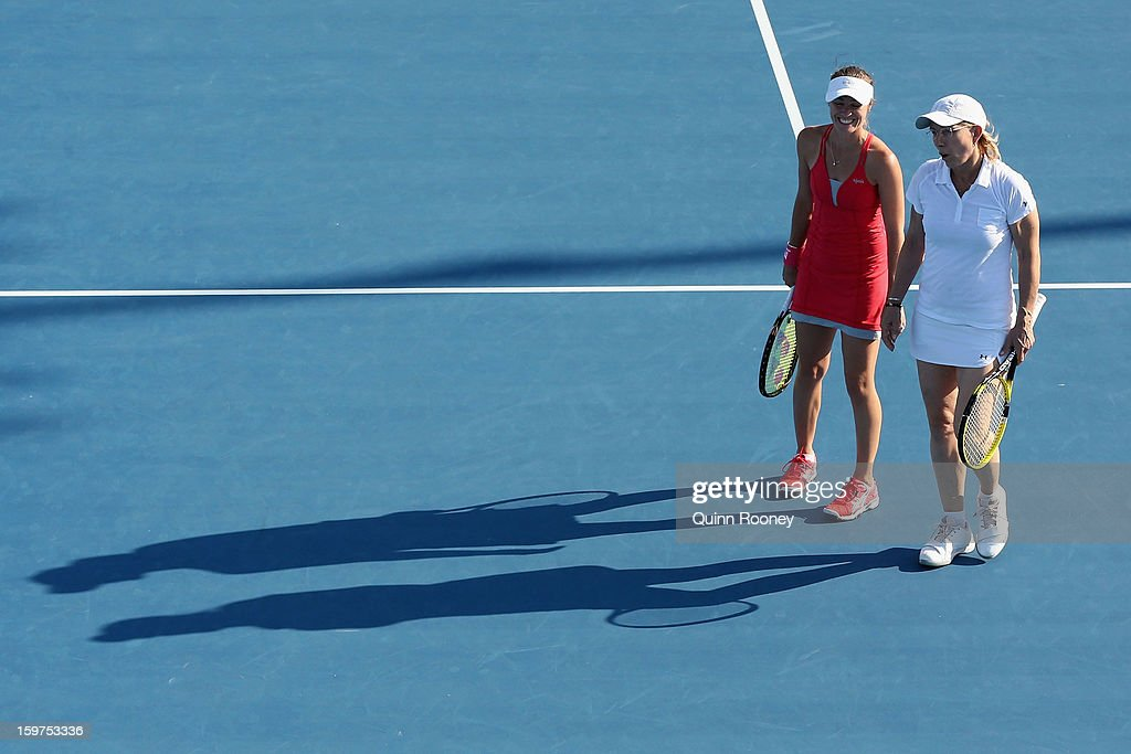 Martina Hingis of Switzerland and Martina Navratilova of the United States of America talk tactics in their legends doubles match against Iva Majoli of Croatia and Barbara Schett Austria during day seven of the 2013 Australian Open at Melbourne Park on January 20, 2013 in Melbourne, Australia.
