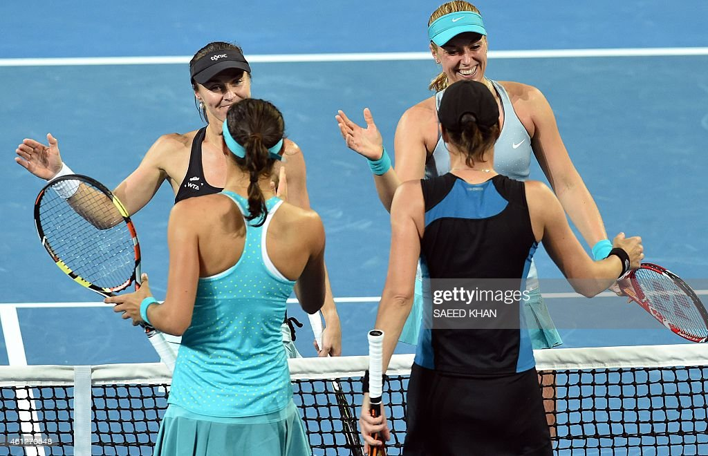 <a gi-track='captionPersonalityLinkClicked' href=/galleries/search?phrase=Martina+Hingis&family=editorial&specificpeople=202183 ng-click='$event.stopPropagation()'>Martina Hingis</a> (L) of Switzerland and Sabina Liscki (R) of Germany shakes hand with <a gi-track='captionPersonalityLinkClicked' href=/galleries/search?phrase=Caroline+Garcia&family=editorial&specificpeople=6605758 ng-click='$event.stopPropagation()'>Caroline Garcia</a> of France and <a gi-track='captionPersonalityLinkClicked' href=/galleries/search?phrase=Katarina+Srebotnik&family=editorial&specificpeople=218044 ng-click='$event.stopPropagation()'>Katarina Srebotnik</a> of Slovenia following their victory in the women's doubles final of the Brisbane International tennis tournament in Brisbane on January 10, 2015. AFP PHOTO / Saeed KHAN IMAGE RESTRICTED TO EDITORIAL USE - STRICTLY NO COMMERCIAL USE