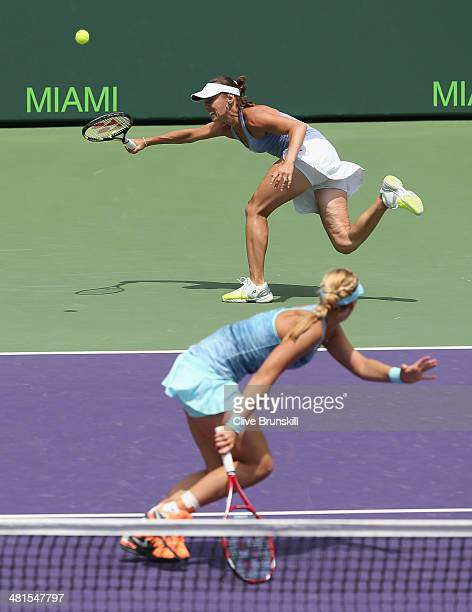 Martina Hingis of Switzerland and Sabine Lisicki of Germany in action against Ekaterina Makarova and Elena Vesnina of Russia during their final match...