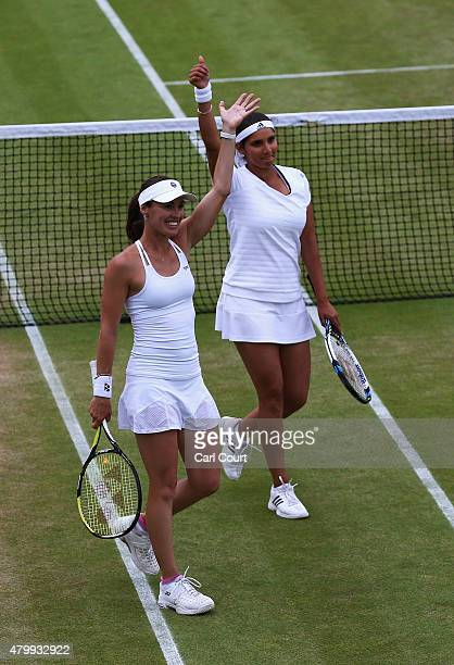 Martina Hingis of Switzerland and Sania Mirza of India celebrate in the Ladies' Doubles against Casey Dellacqua of Australia and Yaroslava Shvedova...