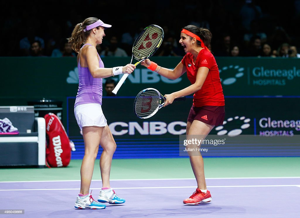 Martina Hingis of Switzerland and Sania Mirza of India celebrate match point in their doubles semi-final match against Hao-Ching Chan and Yung-Jan Chan of Chinese Taipei during BNP Paribas WTA Finals at Singapore Sports Hub on October 31, 2015 in Singapore.