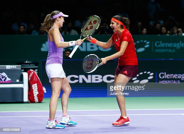 Martina Hingis of Switzerland and Sania Mirza of India celebrate match point in their doubles semifinal match against HaoChing Chan and YungJan Chan...