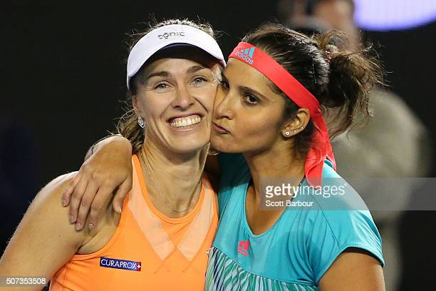 Martina Hingis of Switzerland and Sania Mirza of India celebrate winning championship point in their women's doubles final match against Andrea...