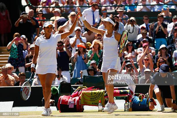Martina Hingis of Switzerland and Sania Mirza of India celebrate winning the Ladies' Doubles Semi Final match against Raquel KopsJones of the United...