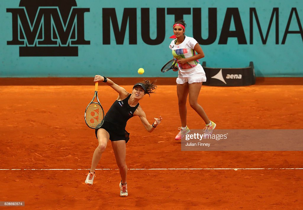 <a gi-track='captionPersonalityLinkClicked' href=/galleries/search?phrase=Martina+Hingis&family=editorial&specificpeople=202183 ng-click='$event.stopPropagation()'>Martina Hingis</a> of Switzerland and <a gi-track='captionPersonalityLinkClicked' href=/galleries/search?phrase=Sania+Mirza&family=editorial&specificpeople=583549 ng-click='$event.stopPropagation()'>Sania Mirza</a> of India in action in the doubles semi final against Vania King of USA and Alla Kudryavtseva of Russia during day seven of the Mutua Madrid Open tennis tournament at the Caja Magica on May 06, 2016 in Madrid, Spain.