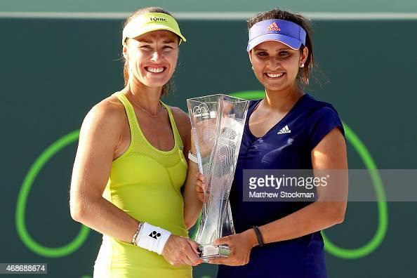 Martina Hingis of Switzerland and Sania Mirza of India pose with the Butch Buchholz Trophy after defeating Ekaterina Makarova and Elena Vesnina of...