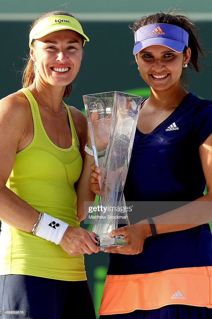 Martina Hingis of Switzerland and Sania Mirza of India pose with the Butch Buchholz Trophy after defeating Ekaterina Makarova and Elena Vesnina of Russia during the doubles final on day 14 of the Miami Open Presented by Itau at Crandon Park Tennis Center on April 5, 2015 in Key Biscayne, Florida.