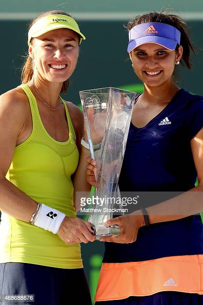 Martina Hingis of Switzerland and Sania Mirza of India pose with the Butch Buchholz Trophy after defeating Ekaterina Makarova and Elena Vesnina of...