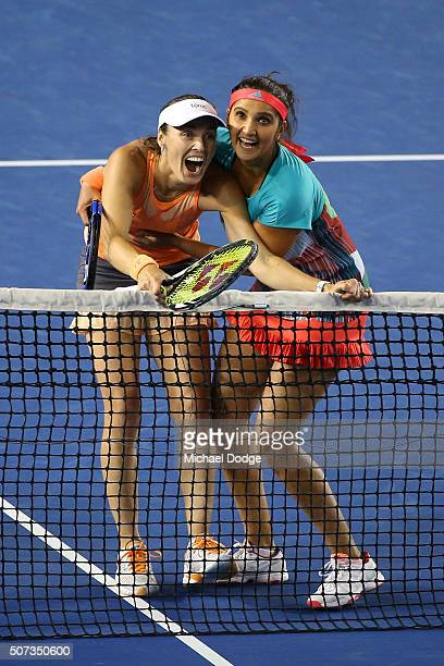 Martina Hingis of Switzerland and Sania Mirza of India react after a line review in their women's doubles final match against Andrea Hlavackova and...