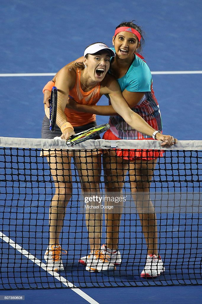 Martina Hingis of Switzerland and Sania Mirza of India react after a line review in their women's doubles final match against Andrea Hlavackova and Lucie Hradecka of the Czeck Republic during day 12 of the 2016 Australian Open at Melbourne Park on January 29, 2016 in Melbourne, Australia.