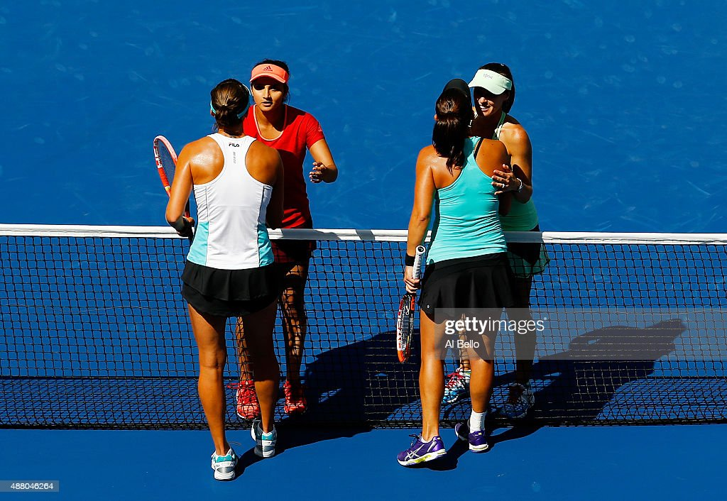 Martina Hingis (Top Left) of Switzerland and Sania Mirza (Top Right) of India shakes hands with Casey Dellacqua (Bottom Right) of Australia and Yaroslava Shvedova (Bottom Left) of Kazakhstan after their Women's Doubles Final on Day Fourteen of the 2015 US Open at the USTA Billie Jean King National Tennis Center on September 13, 2015 in the Flushing neighborhood of the Queens borough of New York City.