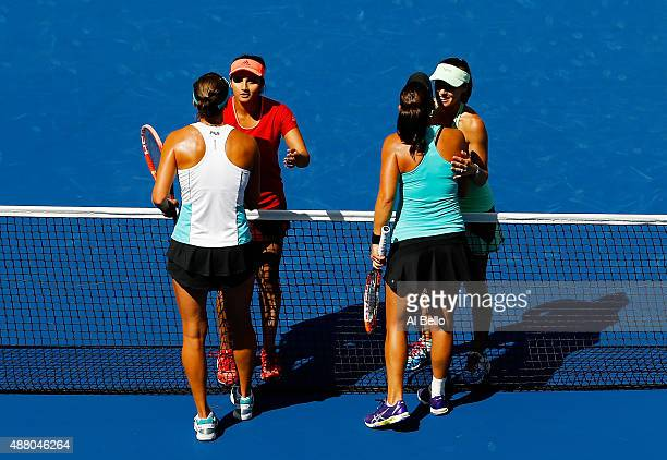 Martina Hingis of Switzerland and Sania Mirza of India shakes hands with Casey Dellacqua of Australia and Yaroslava Shvedova of Kazakhstan after...