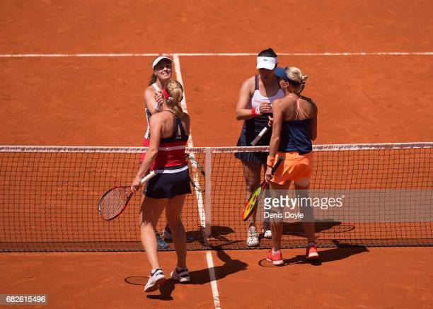Martina Hingis of Switzerland and YungJan Chan of Teipei shake hands with Tomea Babos of Hungary and Andrea Hlavackova of Czech Republic after...
